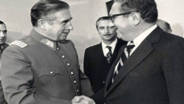 Chilean dictator Augusto Pinochet (L) greets U.S Secretary of State Henry Kissinger (R) in 1976 as Operation Condor was in full swing.