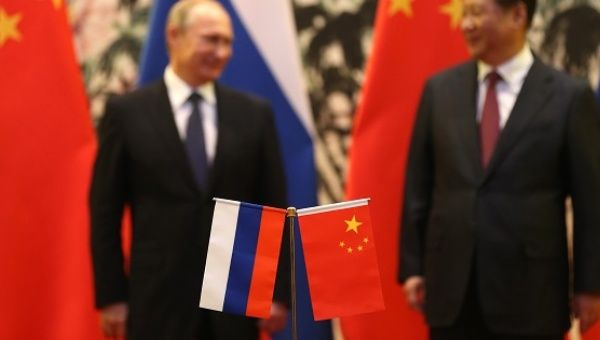 Russian President Vladmir Putin (L) and his Chinese Counterpart exchanged economic and geopolitical strategy at this week