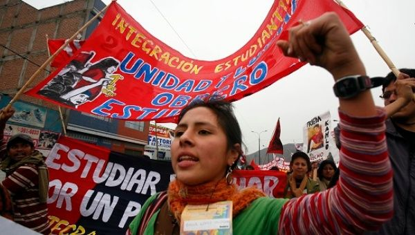 Demonstrators march to participate in the central meeting of the Peoples