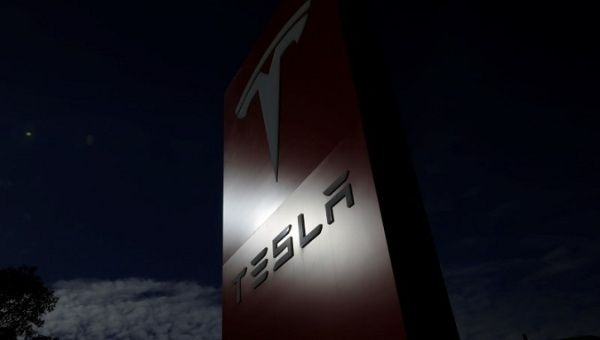 The Tesla corporate logo is pictured at a Tesla electric car dealership in Sydney, Australia.
