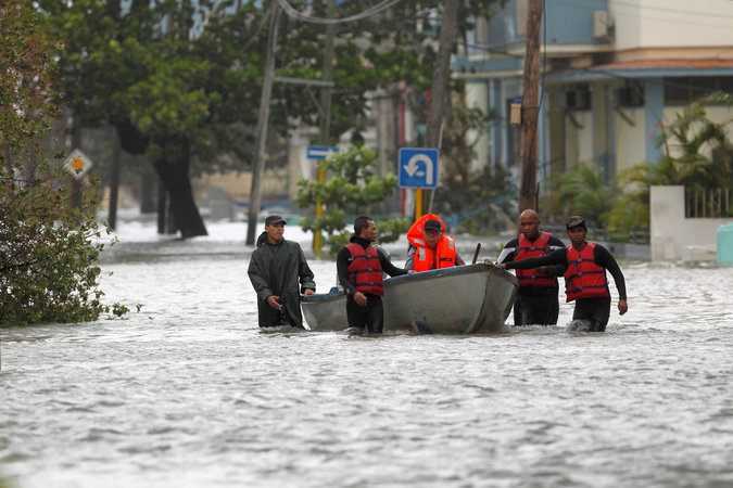 A man is rescued from a flooded neighbourhood