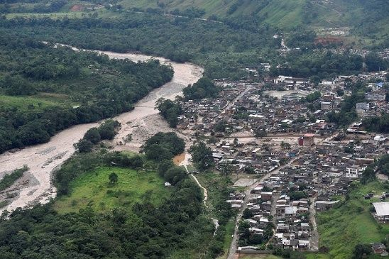 An aerial view shows a flooded area after heavy rains caused several rivers to overflow, pushing sediment and rocks into buildings and roads in Mocoa, Colombia April 1, 2017.