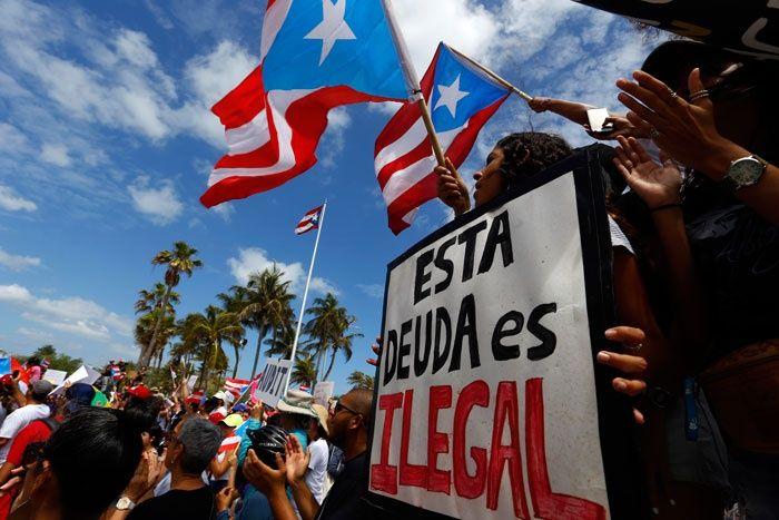 Puertorriqueños exigen que se audite la deuda en la isla. Foto: EFE