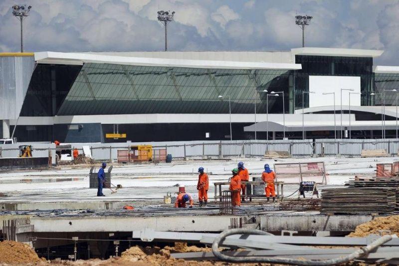 Laborers work at Manaus airport in Manaus, Brazil, June 2, 2014.