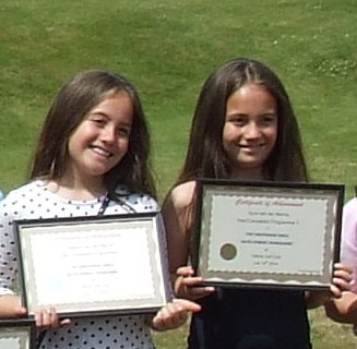 Xyra and Djalece with their Shropshire girl certificates
