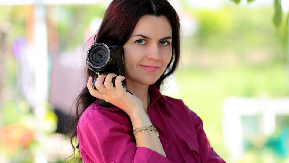 Beautiful woman holding a camera
