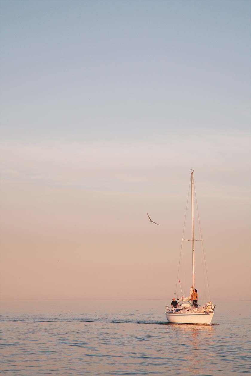 Boat in haze pastel sunset