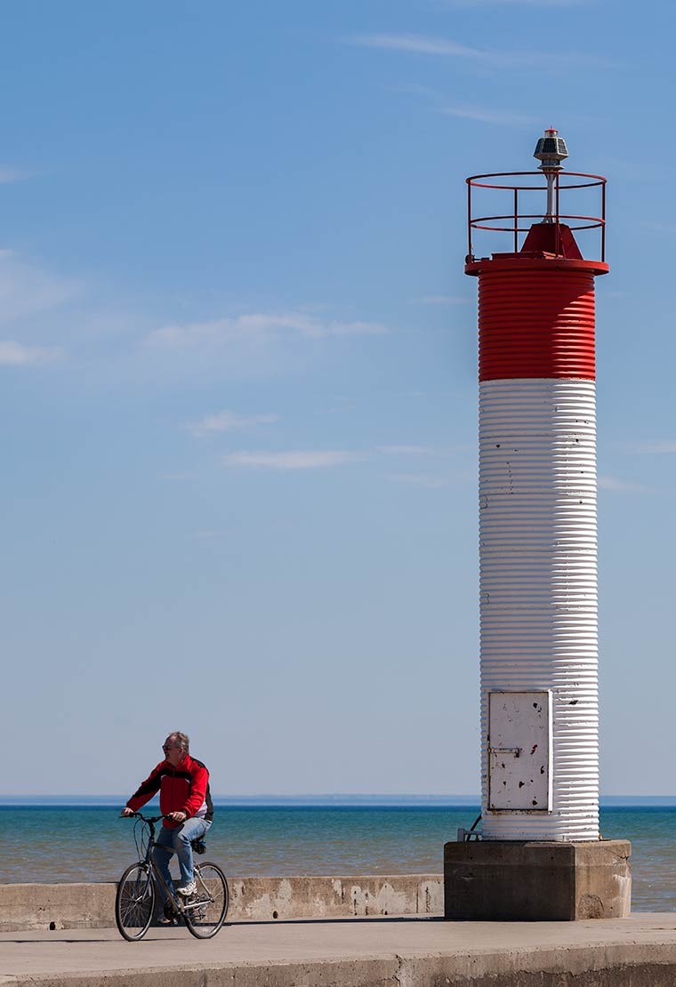 Cyclist by the Lighthouse