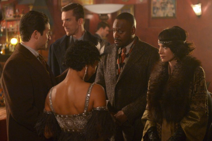 "TIMELESS -- ""The Lost Generation"" Episode 113 -- Pictured: (l-r) Brandon Barash as Hemingway, Malcolm Barrett as Rufus Carlin, Abigail Spencer as Lucy Preston -- (Photo by: Sergei Bachlakov/NBC)"