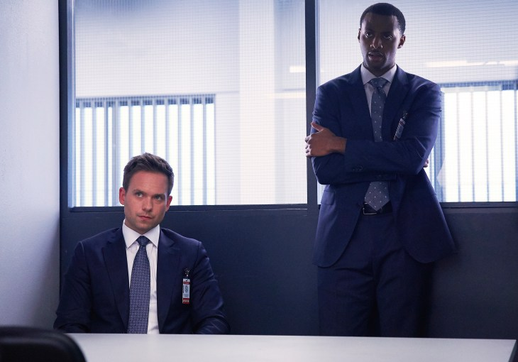 """SUITS -- """"Home to Roost"""" Episode 706 -- Pictured: (l-r) Patrick J. Adams as Michael Ross, Jordan Johnson-Hinds as Oliver Grady -- (Photo by: Shane Mahood/USA Network)"""