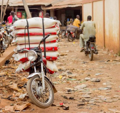 A motorcycle loaded with seven 50kg bags of rice at Igolo, Benin Republic ready to be transported to Nigeria.