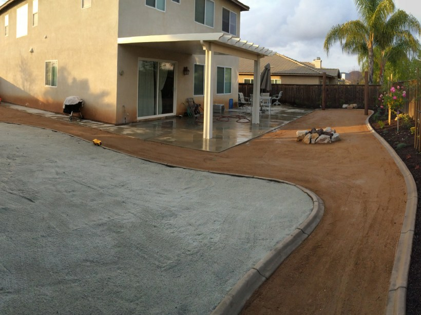 Playground area with fire pit and patio cover in Menifee McCabe's Landscape Construction