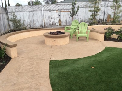 Fire pit with sitting wall and artificial turf in Oceanside McCabe's Landscape Construction