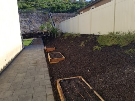 Side yard with pavers and planter boxes