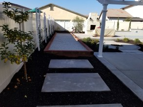 Bocce ball court, plantings, outdoor fireplace