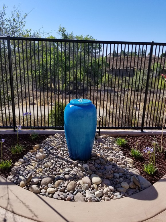 A colorful single pot water feature