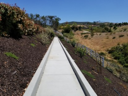 Concrete pathway with concrete retaining walls and curbs