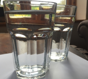 Tap water in drinking glass