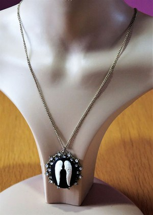 Black and white 3D angel wings jewelled cameo necklace