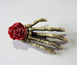 Skeleton hand and rose hair clip