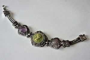 Metallic green lady cameo and purple jewel bracelet