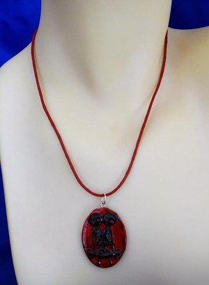 Red Siamese skeleton twins cameo necklace