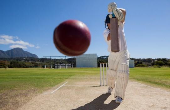 Batsman striking a cricket ball