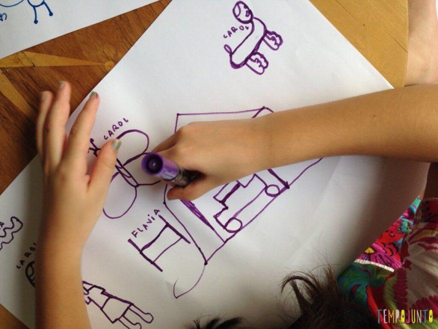 Receita contra o tédio - concurso Quem consegue fazer o melhor desenho sem tirar a caneta do papel - Carol desenhando