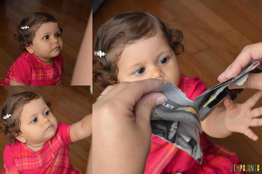Brincadeira com o bebê usando folhas de revista - julia tentando pegar a revista