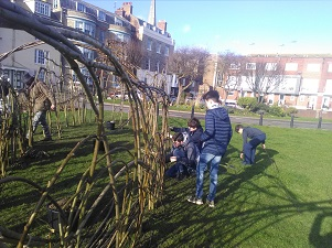 Local Scouts help to plant the willow for the sculpture