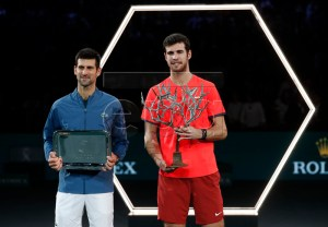 Karen Khachanov of Russia (R) poses with the trophy after winning the final against Novak Djokovic of Serbia (L)  at the Rolex Paris Masters tennis tournament in Paris, France, 04 November 2018.  EPA-EFE/IAN LANGSDON