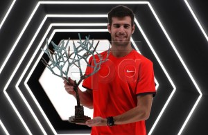 Karen Khachanov of Russia poses with the trophy after winning the final against Novak Djokovic of Serbia at the Rolex Paris Masters tennis tournament in Paris, France, 04 November 2018. EPA-EFE/IAN LANGSDON