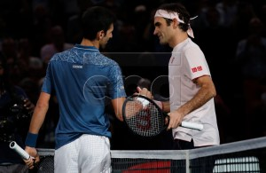 Roger Federer of Switzerland (R) congratulates Novak Djokovic of Serbia after their semifinal match at the Rolex Paris Masters tennis tournament in Paris, France, 03 November 2018. EPA-EFE/CHRISTOPHE PETIT TESSON