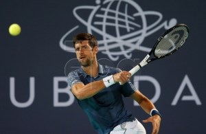Novak Djokovic of Serbia in action during his semi final match against Karen Khachanov of Russia at the Mubadala World Tennis Championship 2018 in Abu Dhabi, United Arab Emirates, 28 December 2018. EPA-EFE/ALI HAIDER