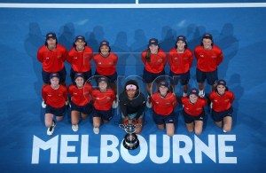 Naomi Osaka of Japan poses with the ball kids during the presentation of the winner's trophy after defeating Petra Kvitova of the Czech Republic in the women's singles final at the Australian Open Grand Slam tennis tournament in Melbourne, Australia, 26 January 2019. EPA-EFE/HAMISH BLAIR EDITORIAL USE ONLY AUSTRALIA AND NEW ZEALAND OUT