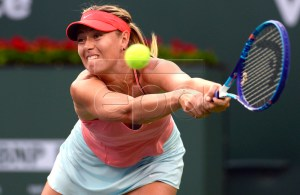 Maria Sharapova of Russia in action during her fourth round match against Flavia Pennetta of Italy at the BNP Paribas Open tennis tournament in Indian Wells, California, USA, 17 March 2015. EPA/MIKE NELSON