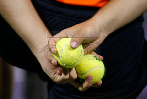 A ball boy holds tournament balls during the quarterfinal match between Juan Martin del Potro of Argentina and Milos Raonic of Canada at the Miami Open tennis tournament on Key Biscayne, Miami, Florida, USA, 28 March 2018.  EPA-EFE/RHONA WISE