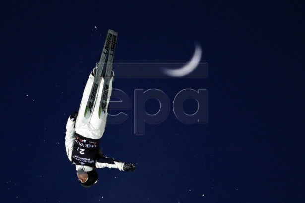 Brittany George of Australia performs a training jump in front of a rising moon before the Team Aerials for the FIS World Championships at Deer Valley Resort in Park City, Utah, USA, 07 February 2019.  EPA-EFE/JEFF SWINGER