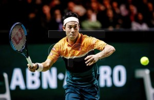 Japanese Kei Nishikori returns the ball to Ernests Gulbis from Latvia during their match at the ABN AMRO World Tennis Tournament in Rotterdam, The Netherlands, 14 February 2019. EPA-EFE/ROBIN VAN LONKHUIJSEN