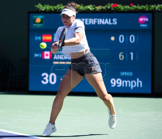 Bianca Andreescu of Canada in action against Garbine Muguruza of Spain during the BNP Paribas Open tennis tournament at the Indian Wells Tennis Garden in Indian Wells, California, USA, 13 March 2019. The men's and women's final will be played, 17 March 2019.  EPA-EFE/JOHN G. MABANGLO