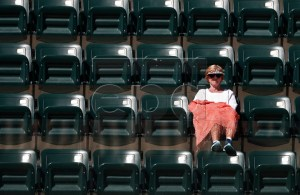 A woman sits in the stands during the Karen Khachanov of Russia match against John Isner of United States during the BNP Paribas Open tennis tournament at the Indian Wells Tennis Garden in Indian Wells, California, USA, 13 March 2019. The men's and women's final will be played, 17 March 2019. EPA-EFE/LARRY W. SMITH