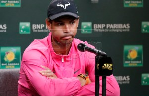 Rafael Nadal of Spain reacts to questions after announcing his withdrawal from his semifinal match against Roger Federer of Switzerland due to injury during the BNP Paribas Open tennis tournament at the Indian Wells Tennis Garden in Indian Wells, California, USA, 16 March 2019. The men's and women's final will be played, 17 March 2019. EPA-EFE/JOHN G. MABANGLO