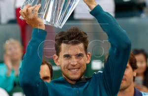 Dominic Thiem of Austria holds up his trophy after defeating Roger Federer of Switzerland during the BNP Paribas Open tennis tournament at the Indian Wells Tennis Garden in Indian Wells, California, USA, 17 March 2019. EPA-EFE/JOHN G. MABANGLO