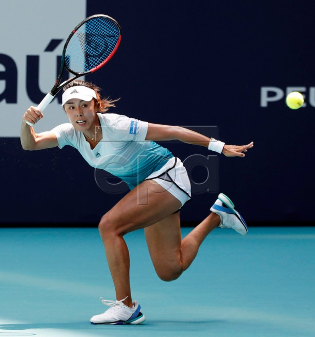 Wang Qiang of China in action against Simona Halep of Romania during their women's quarterfinals singles match at the Miami Open tennis tournament in Miami, Florida, USA, 27 March 2019. EPA-EFE/JASON SZENES