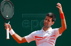 Novak Djokovic of Serbia reacts during his quarterfinal match against Daniil Medvedev of Russia at the Monte-Carlo Rolex Masters tournament in Roquebrune Cap Martin, France, 19 April 2018. EPA-EFE/SEBASTIEN NOGIER