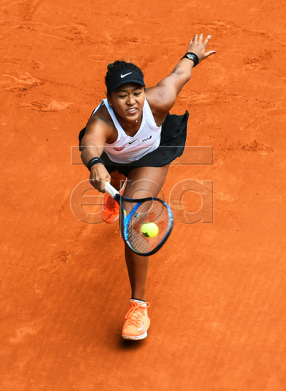Naomi Osaka of Japan in action against Aliaksandra Sasnovich of Belarus during their third round match of the Mutua Madrid Open tennis tournament at the Caja Magica complex in Madrid, Spain, 08 May 2019. EPA-EFE/FERNANDO VILLAR