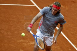 Stefanos Tsitsipas of Greece in action against Alexander Zverev of Germany during their quarter final match at the Mutua Madrid Open tennis tournament in Madrid, Spain, 10 May 2019. EPA-EFE/JAVIER LIZON