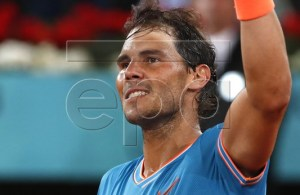 Spanish tennis player Rafael Nadal celebrates after defeating Swiss Stan Wawrinka at the end of their quarterfinal match played at the Mutua Madrid Open tennis tournament in Madrid, Spain, 10 May 2019. EPA-EFE/JAVIER LIZON