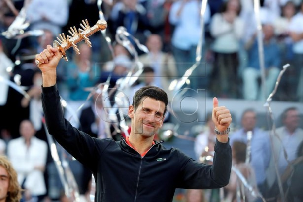 Novak Djokovic of Serbia celebrates with his trophy after winning the final match against Stefanos Tsitsipas of Greece at the Mutua Madrid Open tennis tournament, in Madrid, Spain, 12 May 2019.  EPA-EFE/KIKO HUESCA