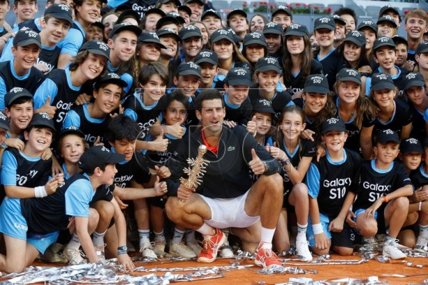 Novak Djokovic of Serbia poses for the photographers after his victory against Stefanos Tsitsipas of Greece (unseen) during their Mutua Madrid Open tennis final game at Caja Magica, in Madrid, Spain, 12 May 2019.  EPA-EFE/KIKO HUESCA